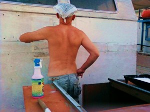wheel house gets a coat of paint...derek gets a tan
